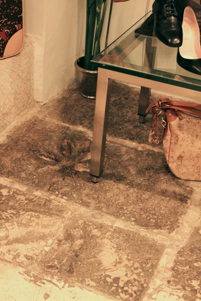 Roman sewage drain in shoe store