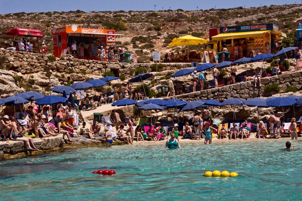 Comino-Packed-Beach-974x649