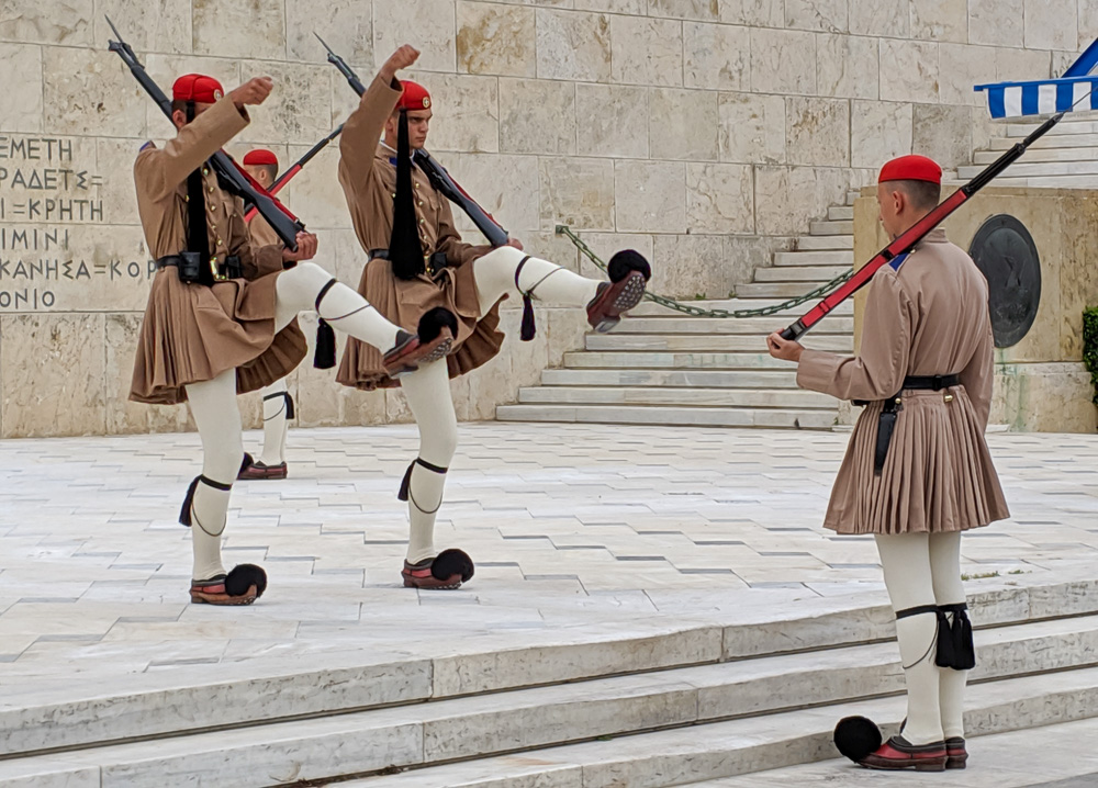 Athens guards kick their legs during the changing of the guard ceremony in Athens