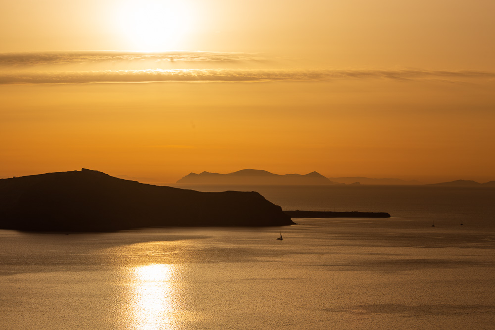 A yellow sky during sunset in Santorini