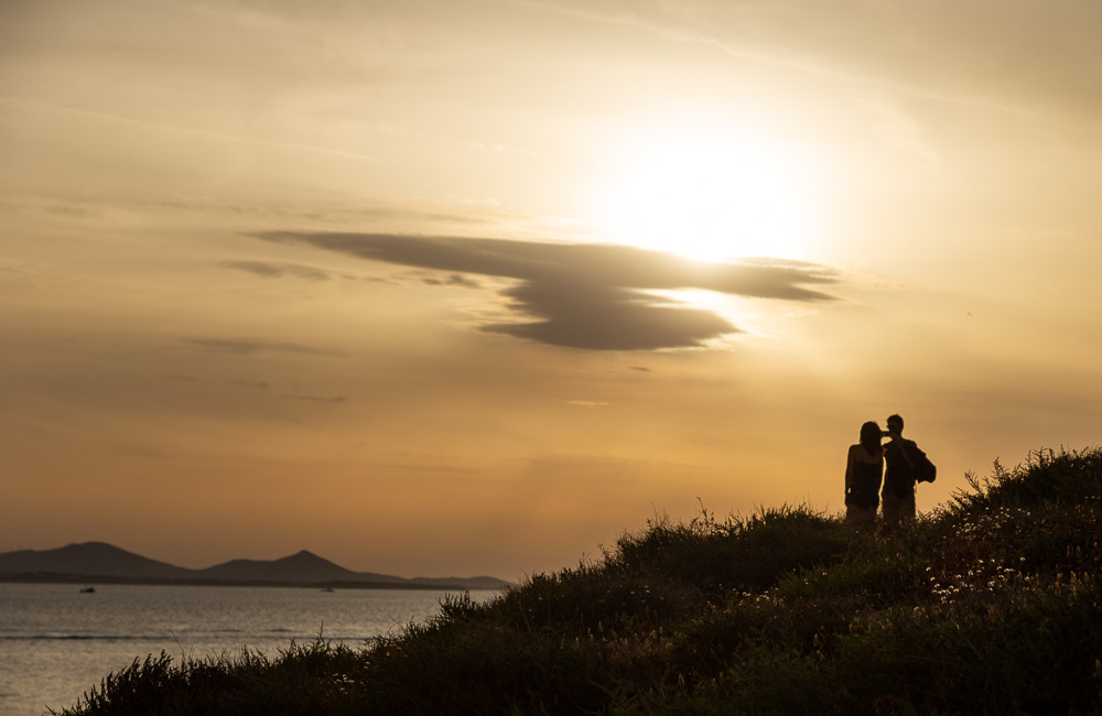 A couple shares the sunset in Naxos, Greece